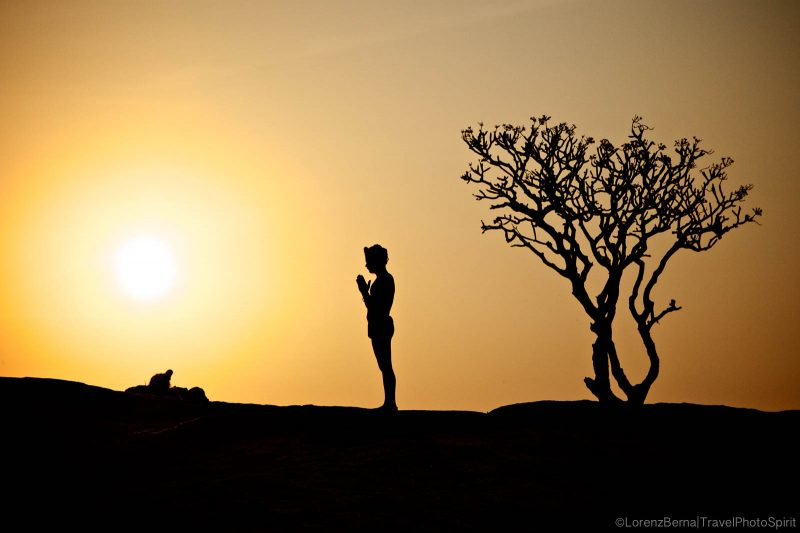 Morning puja by a yogi man on top of a hill in Hampi - A Lorenz Berna Photography of India