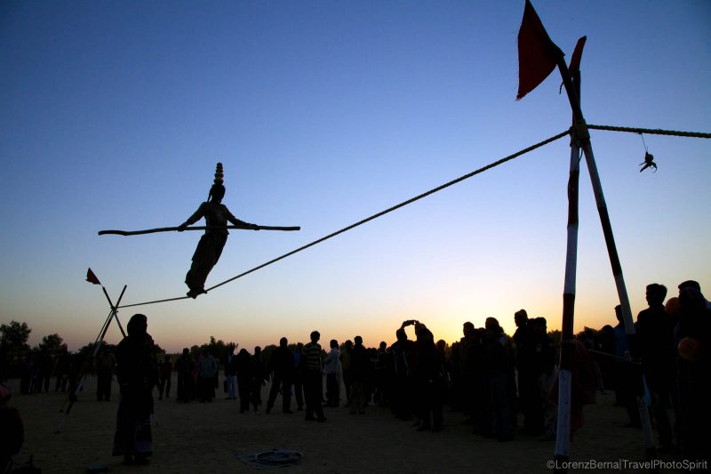 A 12 years old girl is performing tightrope walking at the Desert Festival in Jaisalmer - A Lorenz Berna Photography of India
