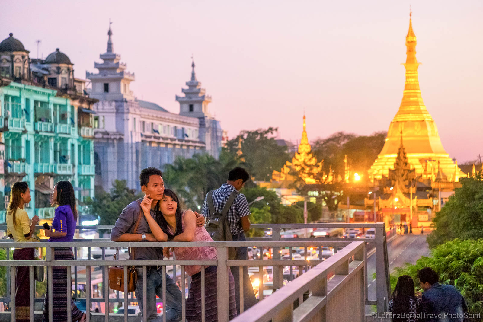 A young couple on a bridge near the Sule Pagoda of Yangon - A Lorenz Berna Travel Photography of Myanmar
