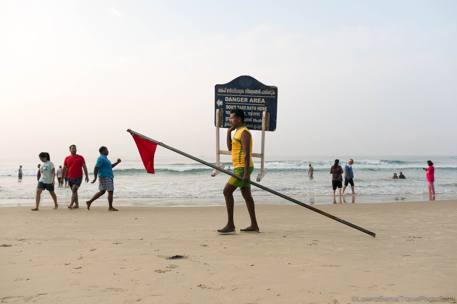 Early morning activity for people walking on Kovalam beach, Kerala - A travel photography of India