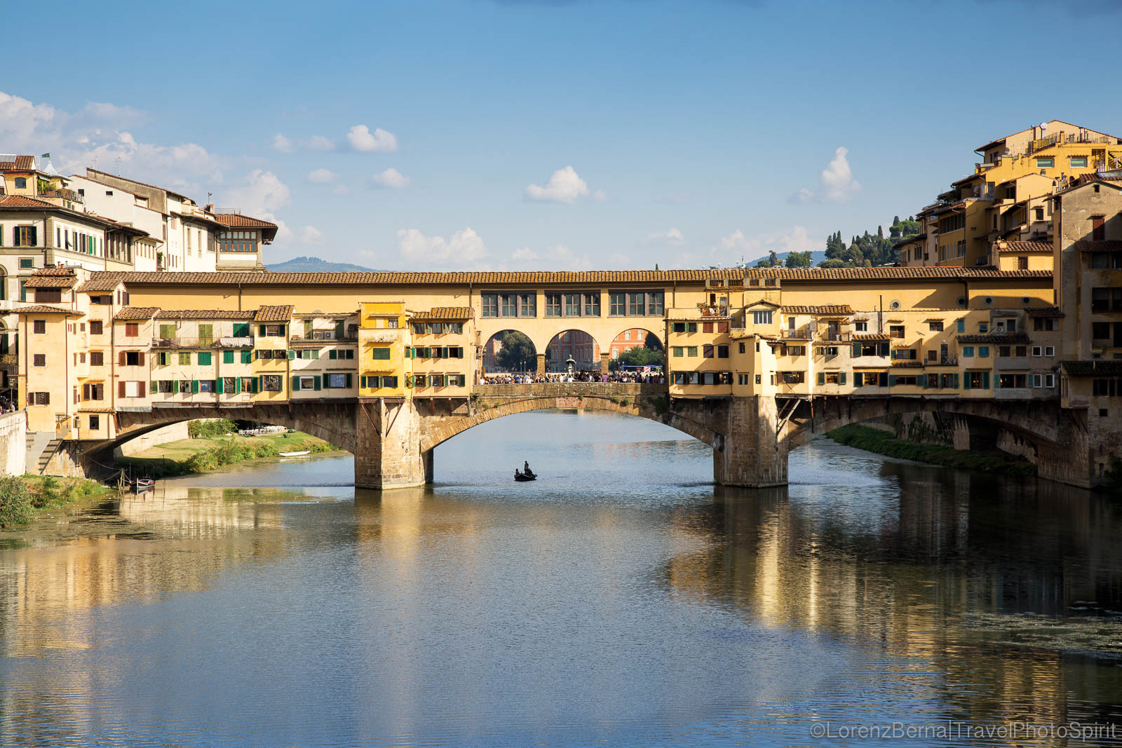 The City emblematic Ponte Vecchio (Old Bridge) crossing over the Arno river, Florence, Tuscany, Italy.