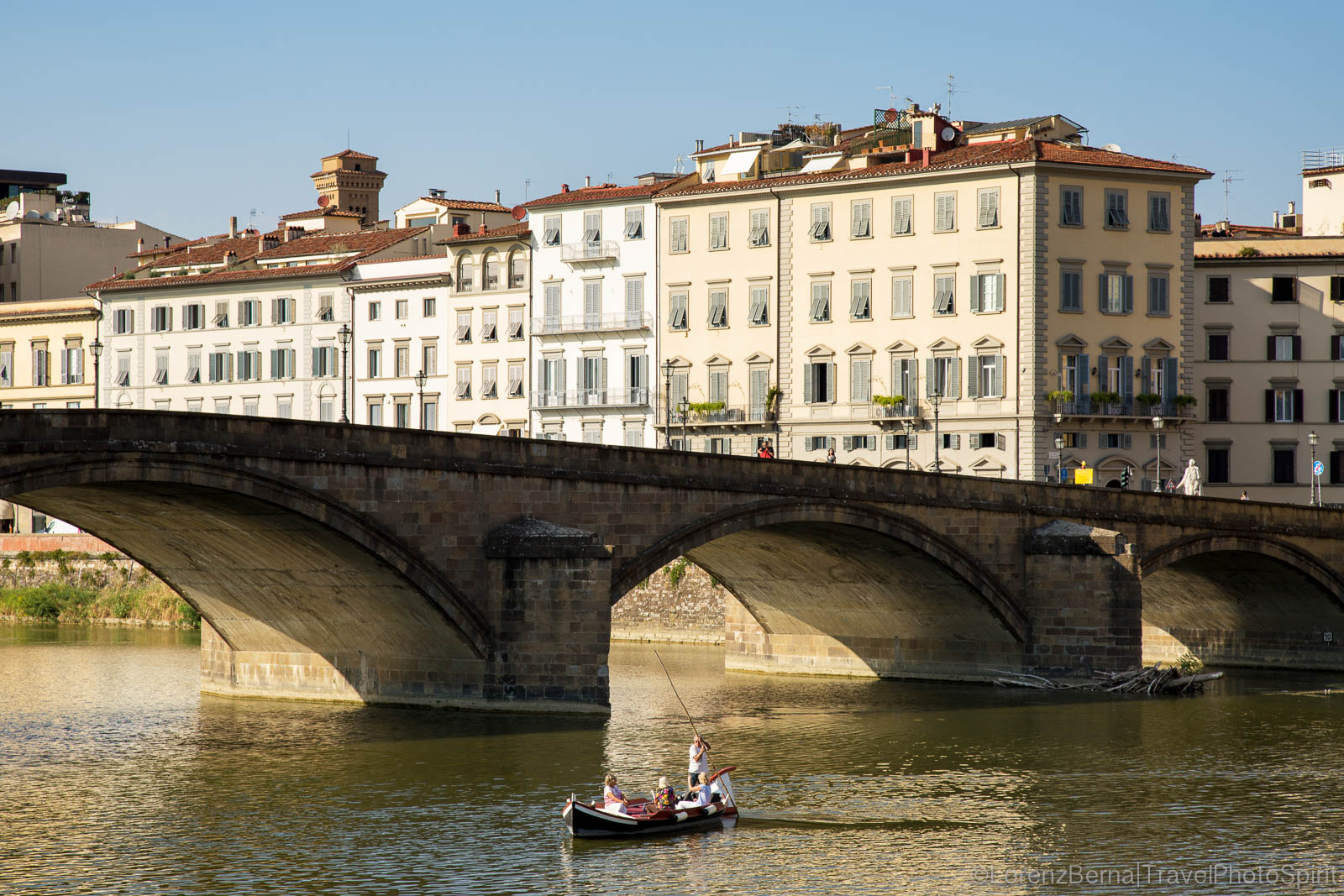Group of tourist on a boat trip on the Arno River, Florence, Tuscany, Italy.