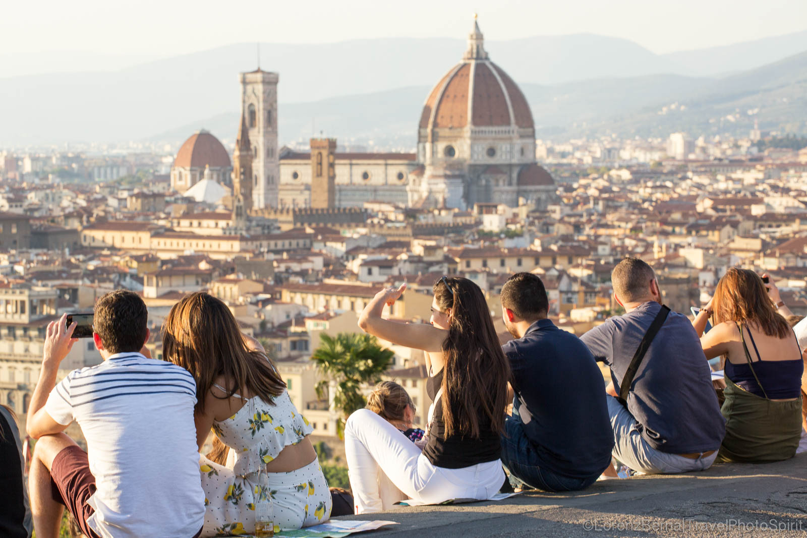 Group of friends enjoying the view over Florence from the Piazzale Michelangelo.