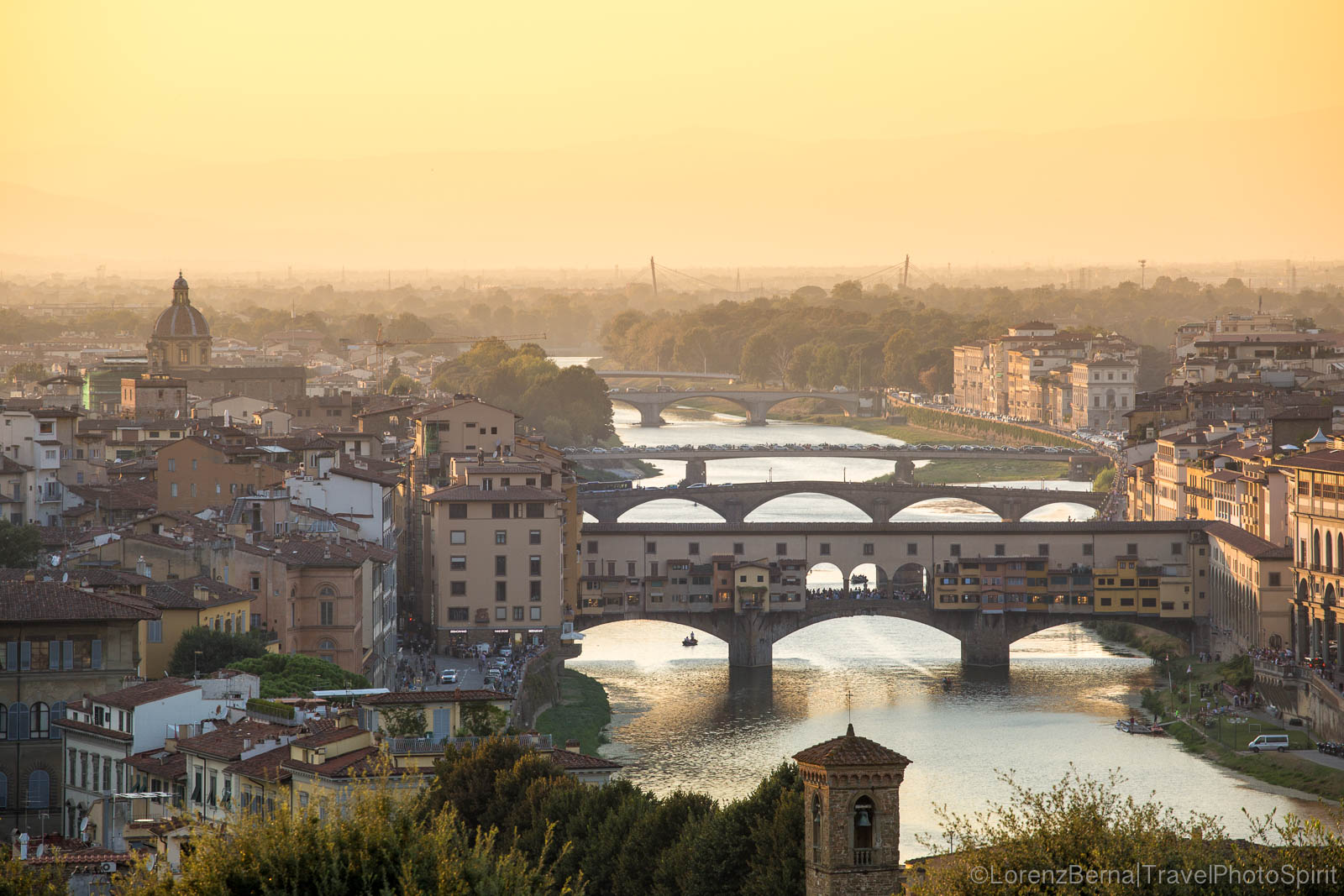 Ponte Vecchio and the Arno river at the golden hours, Florence, Tuscany - Italy Travel Photography by Lorenz Berna