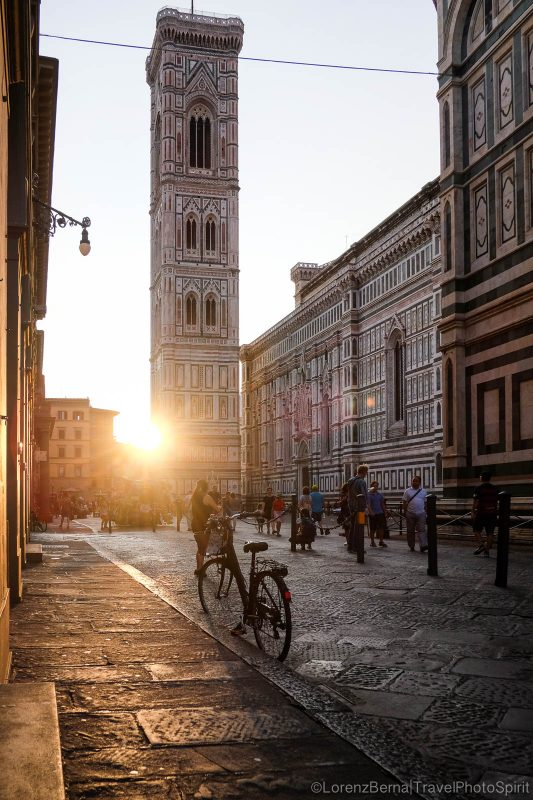 Sunrise piercing in between the buildings of the Santa Maria del Fiore Cathedral in FLorence, Tuscany, Italy.