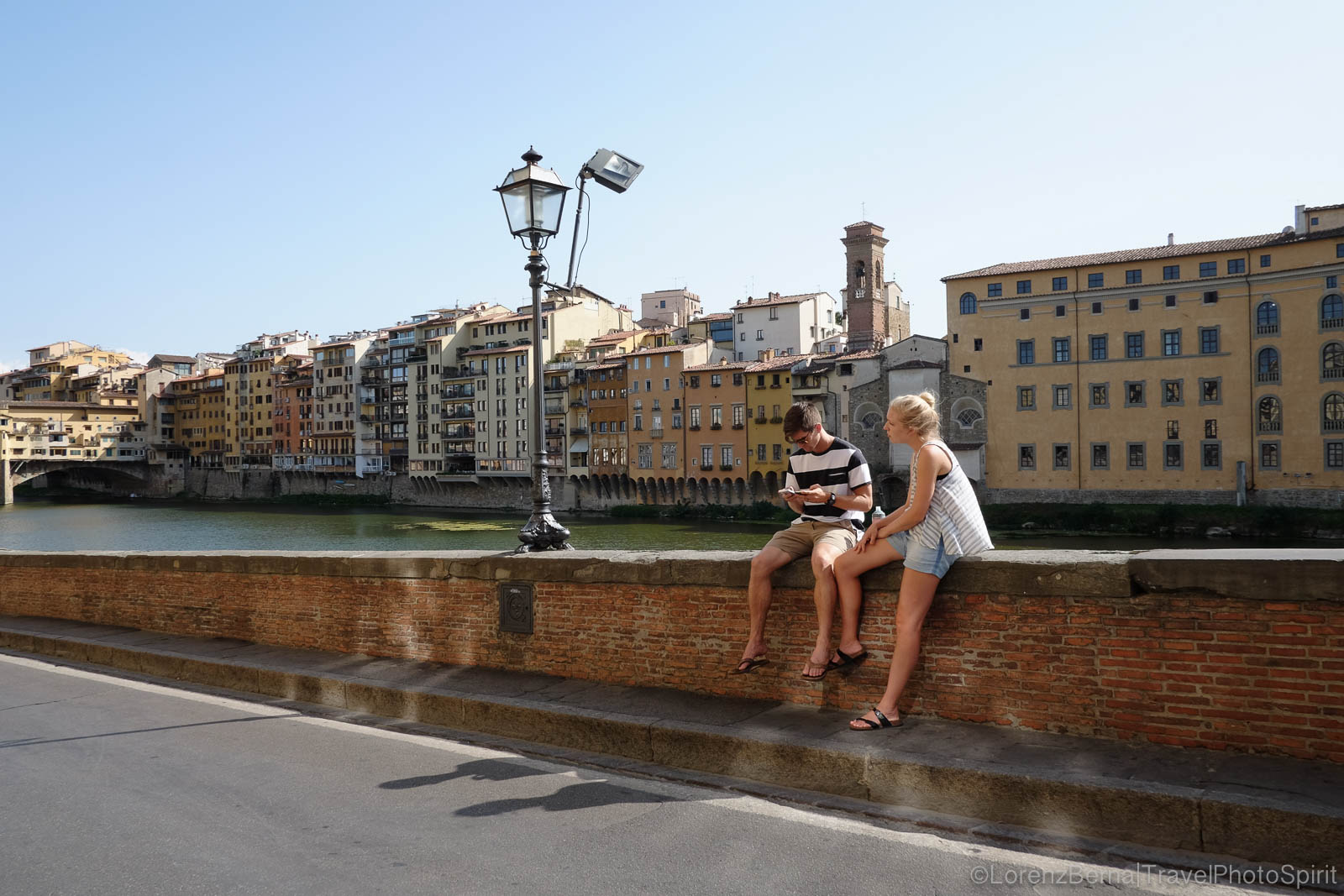 Chat over the Arno River, Florence, Tuscany, Italy.