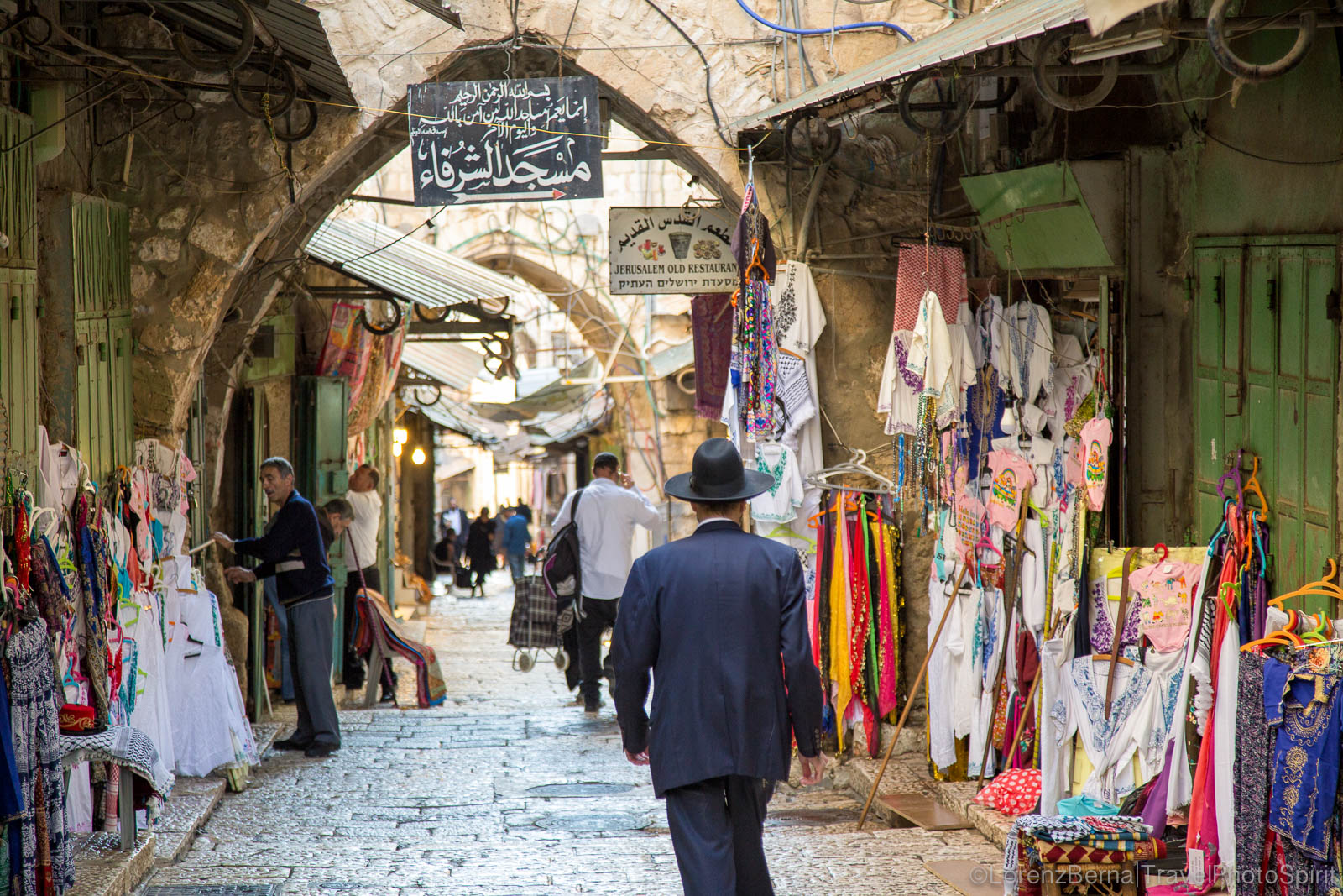 Jewish man walking in the souks of the Muslim Quarter, Jerusalem, Israel.