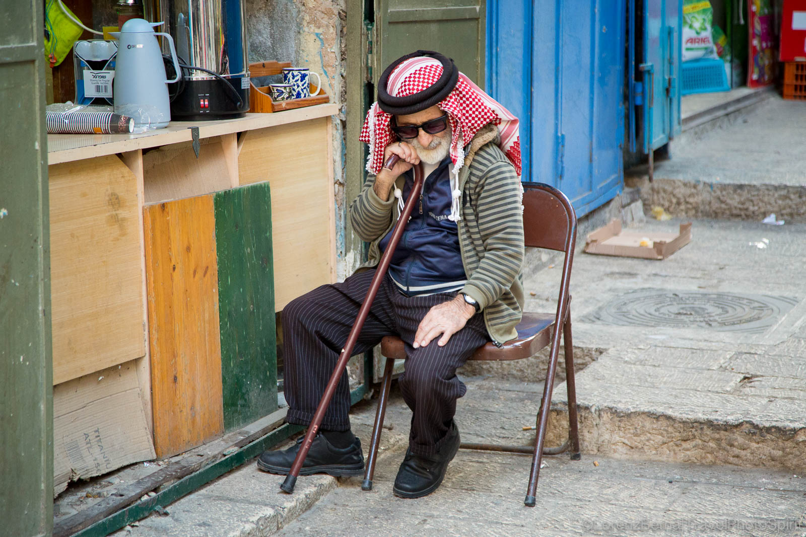 Old Palestinian man sitting in front of a shop in the Muslim quarter of the Old City of Jerusalem, Israel.