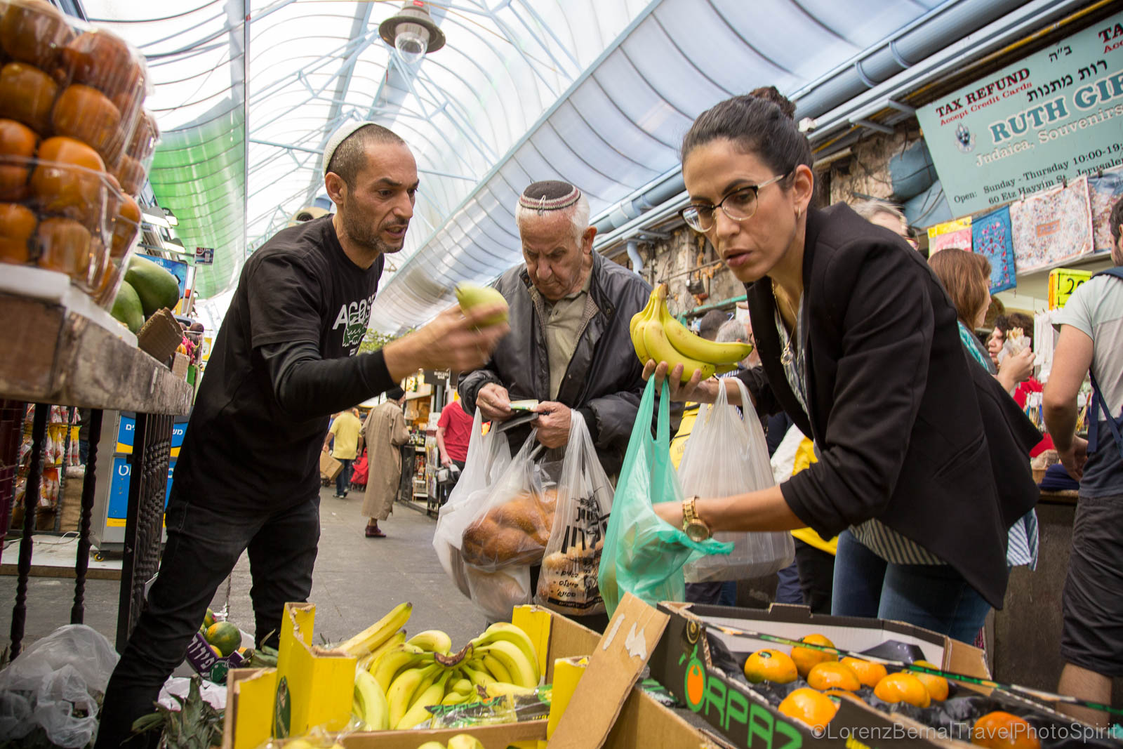 Local people buying fresh fruits in Mahane Yehuda Market, Jerusalem, Israel.