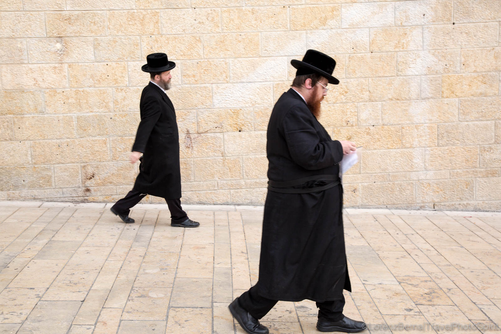 Jewish men walking towards the Western Wall in Jerusalem - A Lorenz Berna Street Photo in Jerusalem.