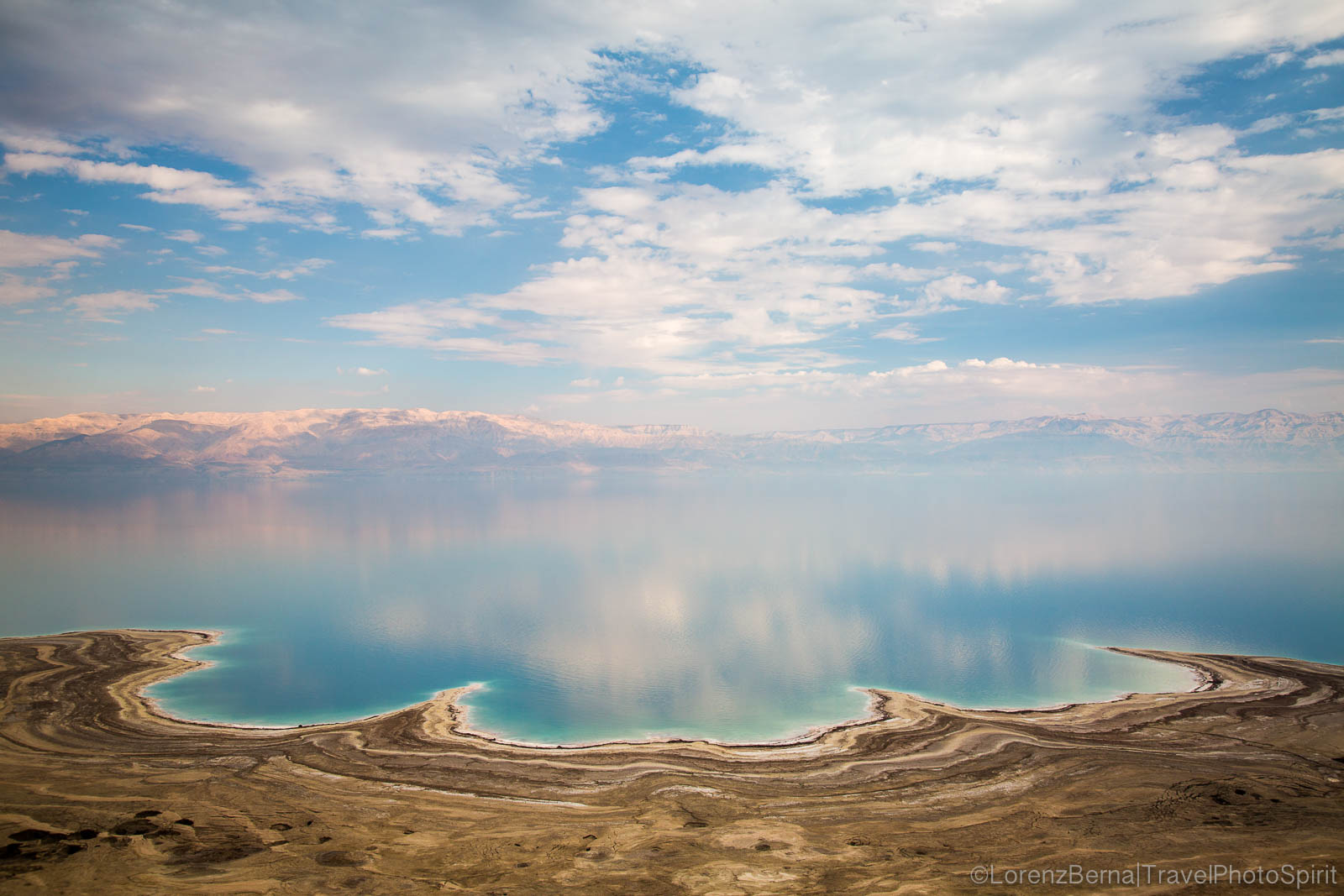 Unique landscape of the Dead Sea in the mist of heat, overlooking the desert hills of Jordan, Israel.