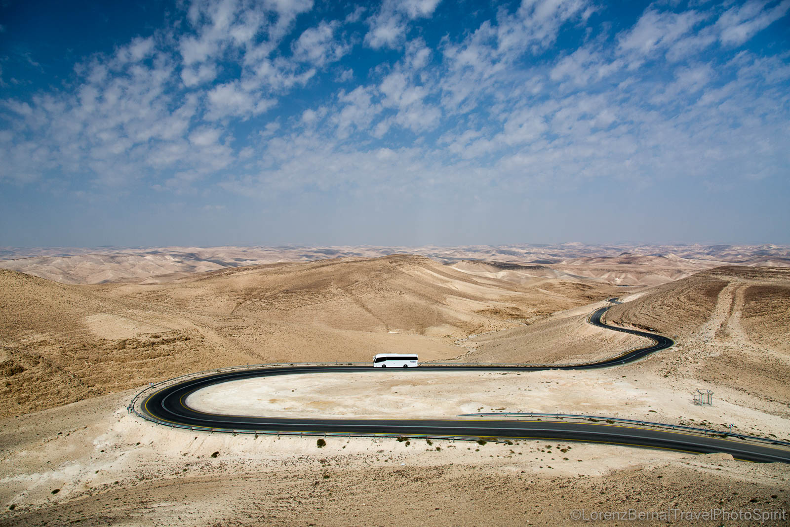 A tourist bus riding the weaving roads of the Judean Desert, Israel.