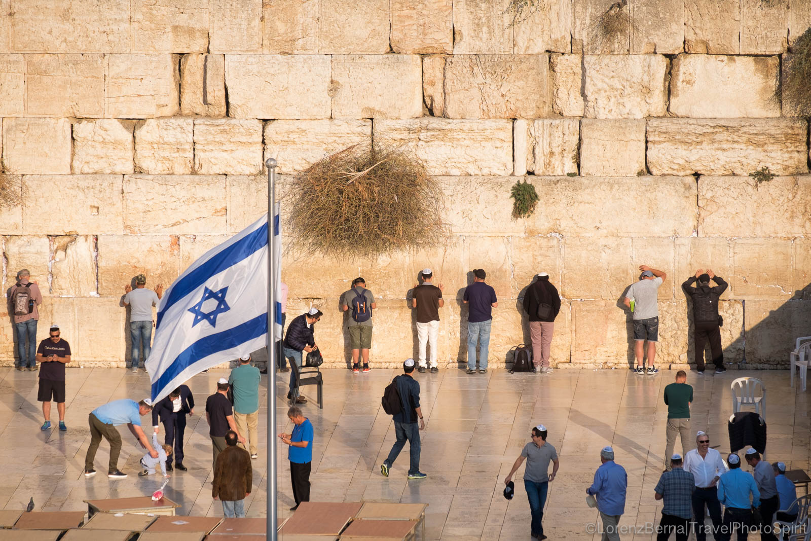 "Jewish men praying along the Western Wall, best known as the ""Wailing Wall"", Jerusalem, Israel."
