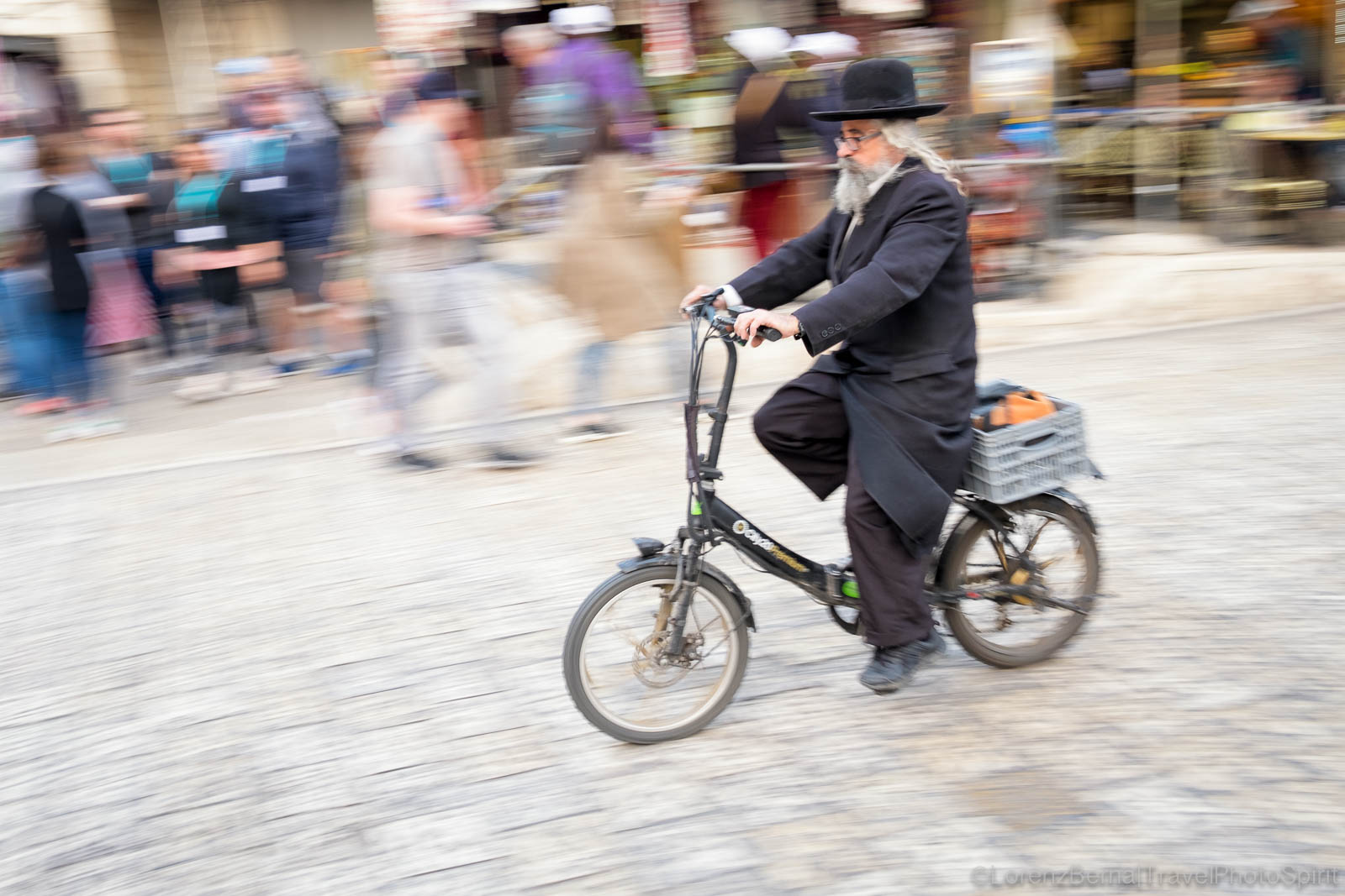 Old man on an electrical bike, in the Jewish Quarter of Jerusalem, Israel.