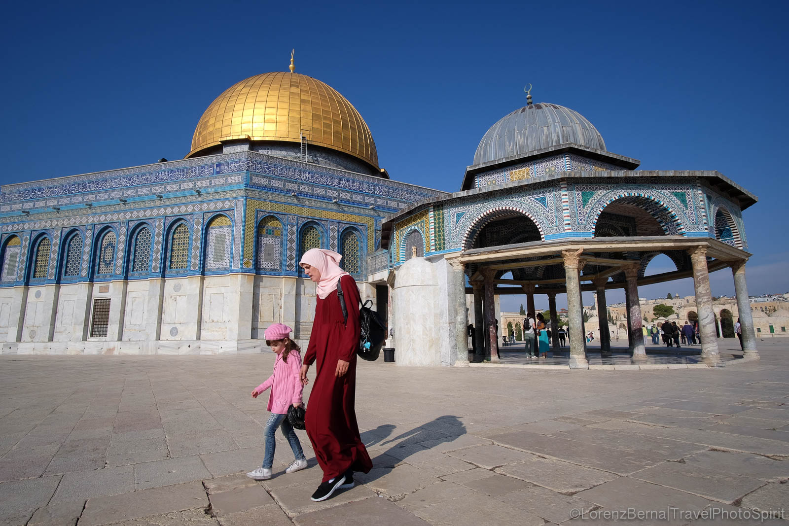 Mother and daughter went to pray on a holy Friday, at the Dome of the Rock mosque, Jerusalem, Israel.