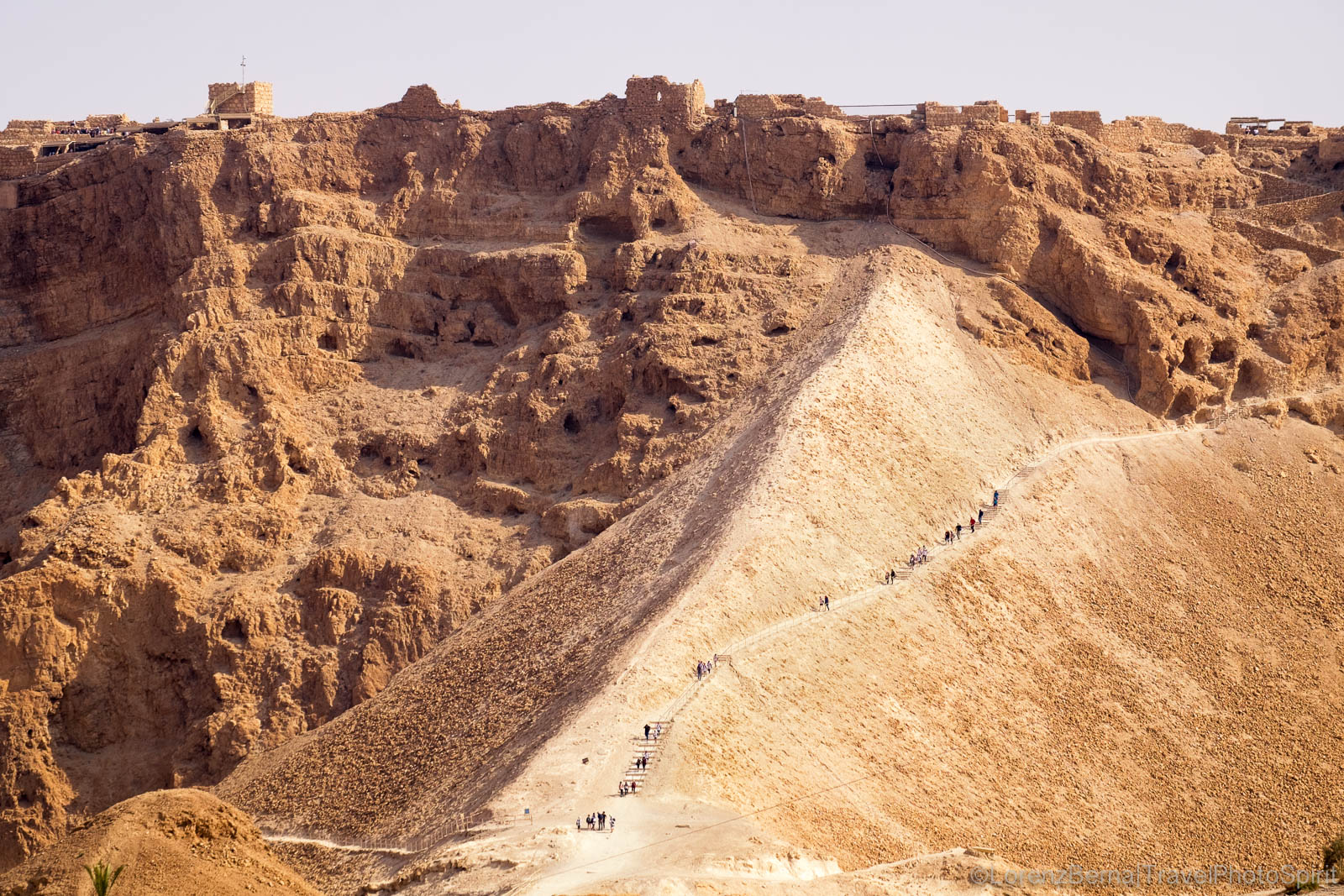 People getting down the rocky slopes of Masada, Judean Desert, Jerusalem.