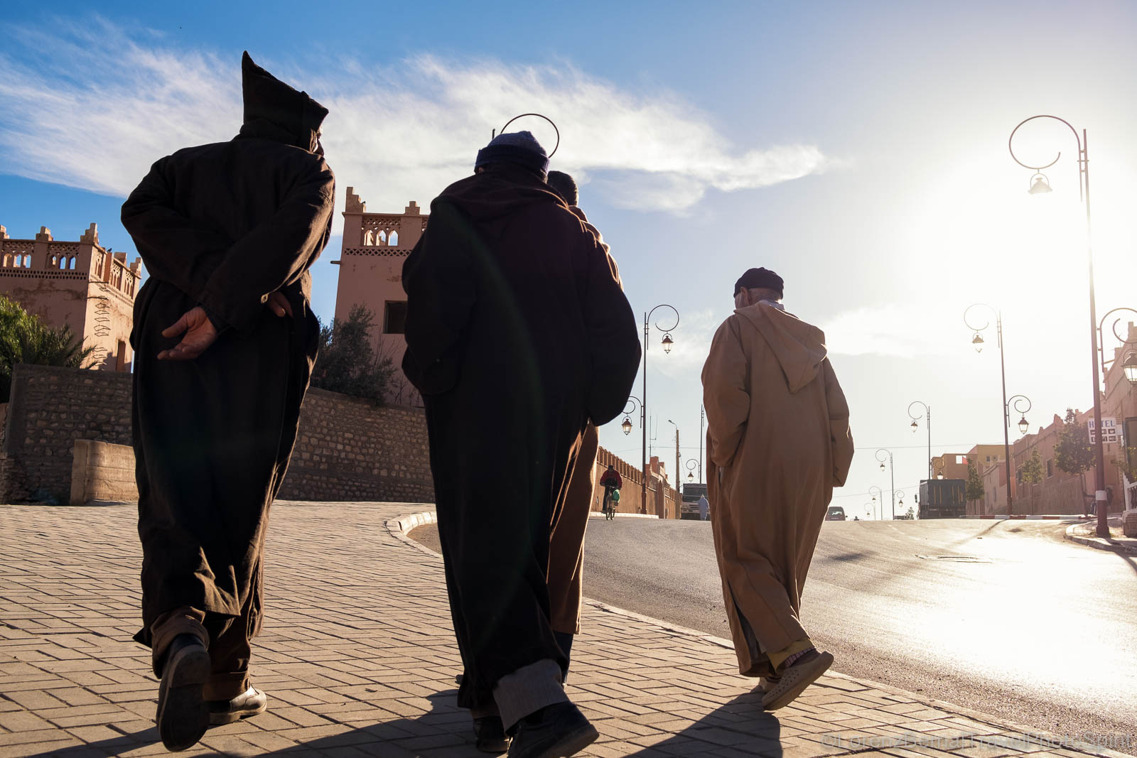 Silhouettes of men in the traditional Djellaba in Tinghir, Morocco