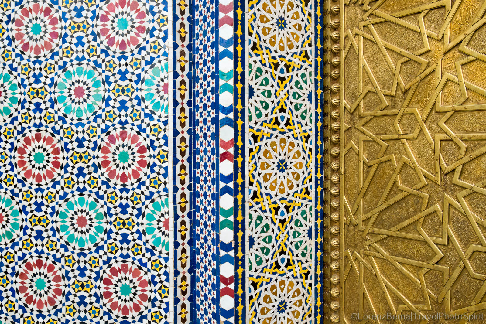 Mosaic designs and patterns standing by the golden gates of the Royal Palace in Fes, Morocco.