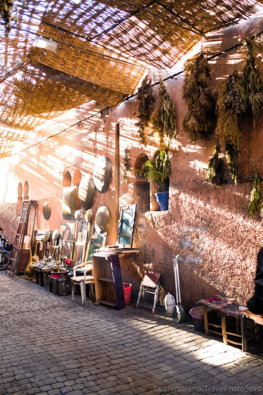 A street of a Marrakech Medina illuminated by the filtering light.