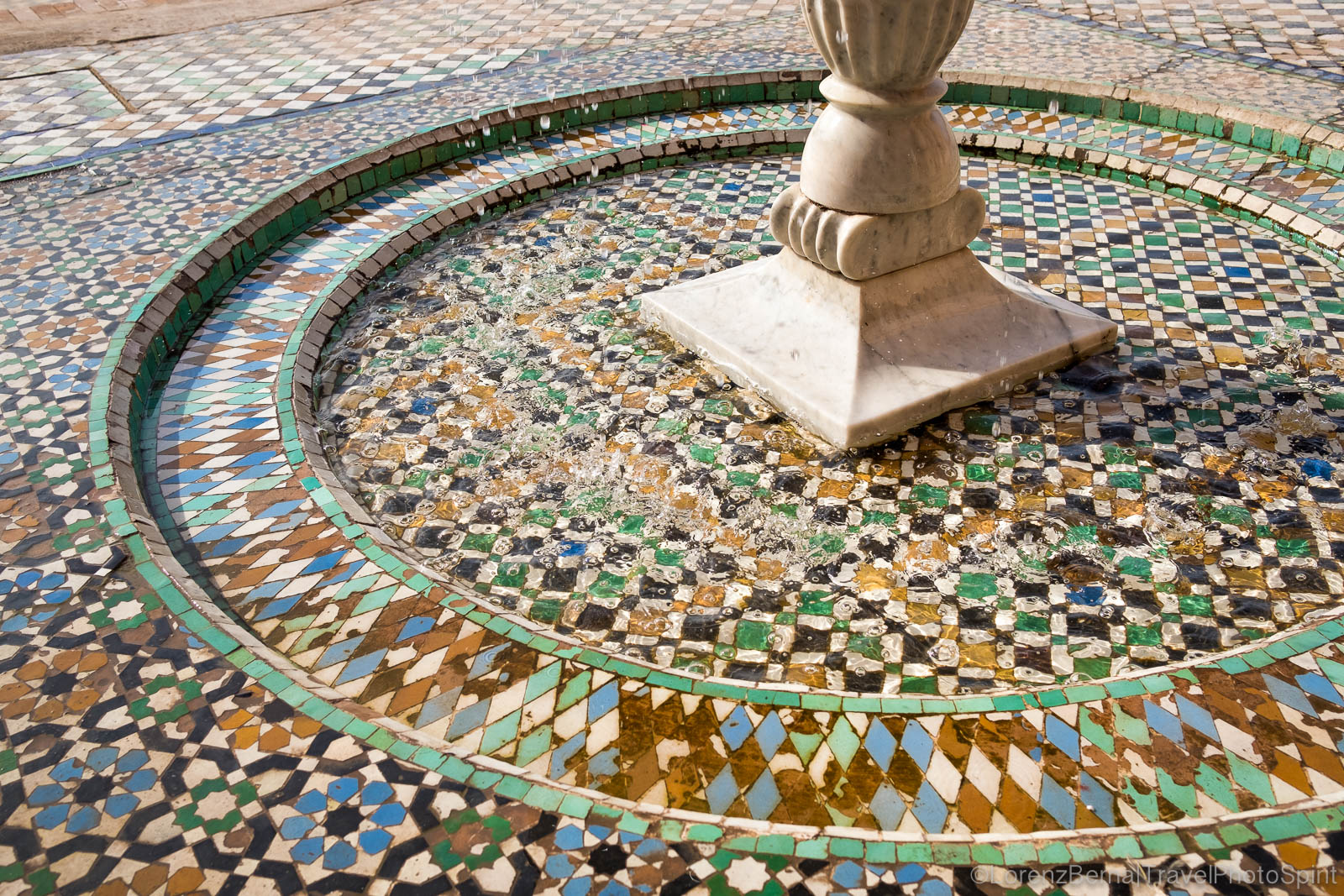 Detail of a water fountain with mosaics inside El Badi palace in Marrakech
