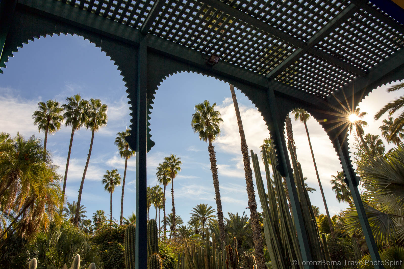 Palm trees framed in the arches of the Majorelle gardens of Marrakech, Morocco
