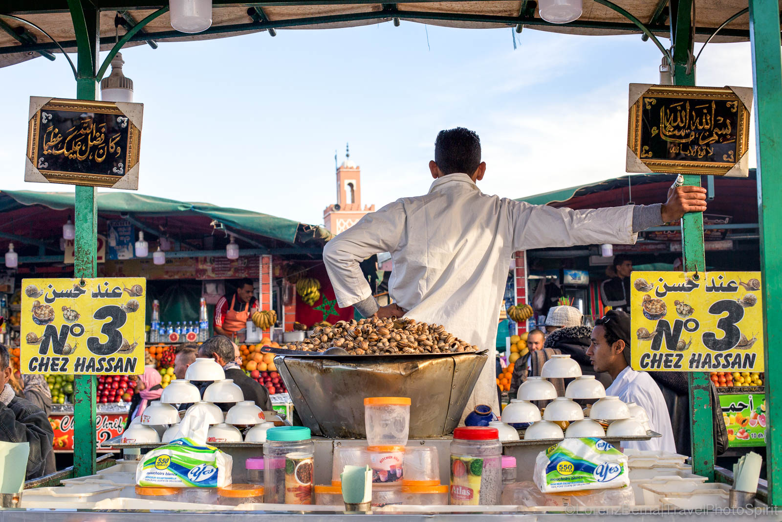 Street food stall in the Djema el fnaa, with Koutoubia Mosque in background.