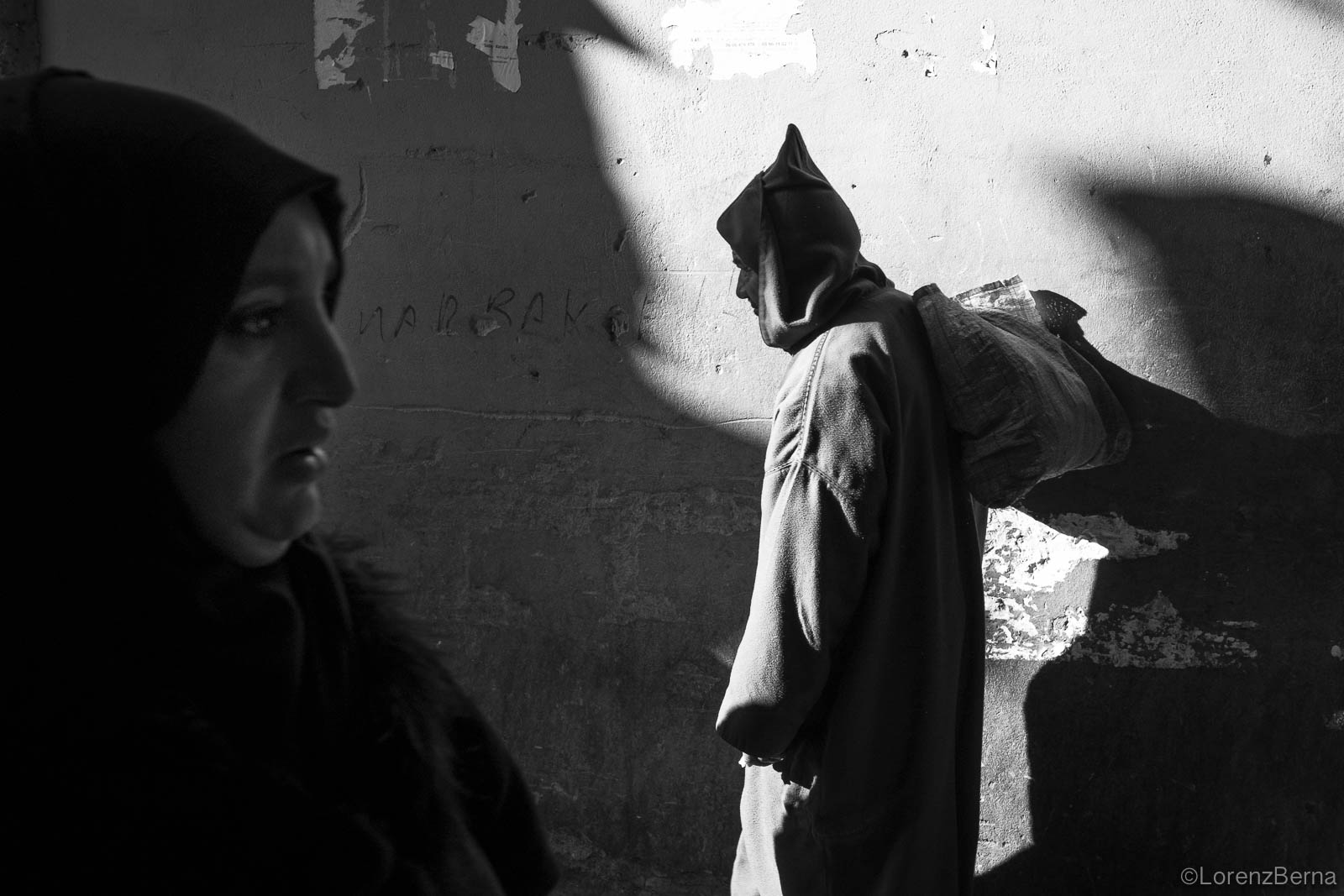 The pointed, hooded moroccan djellaba in silhouette, Morocco photos.