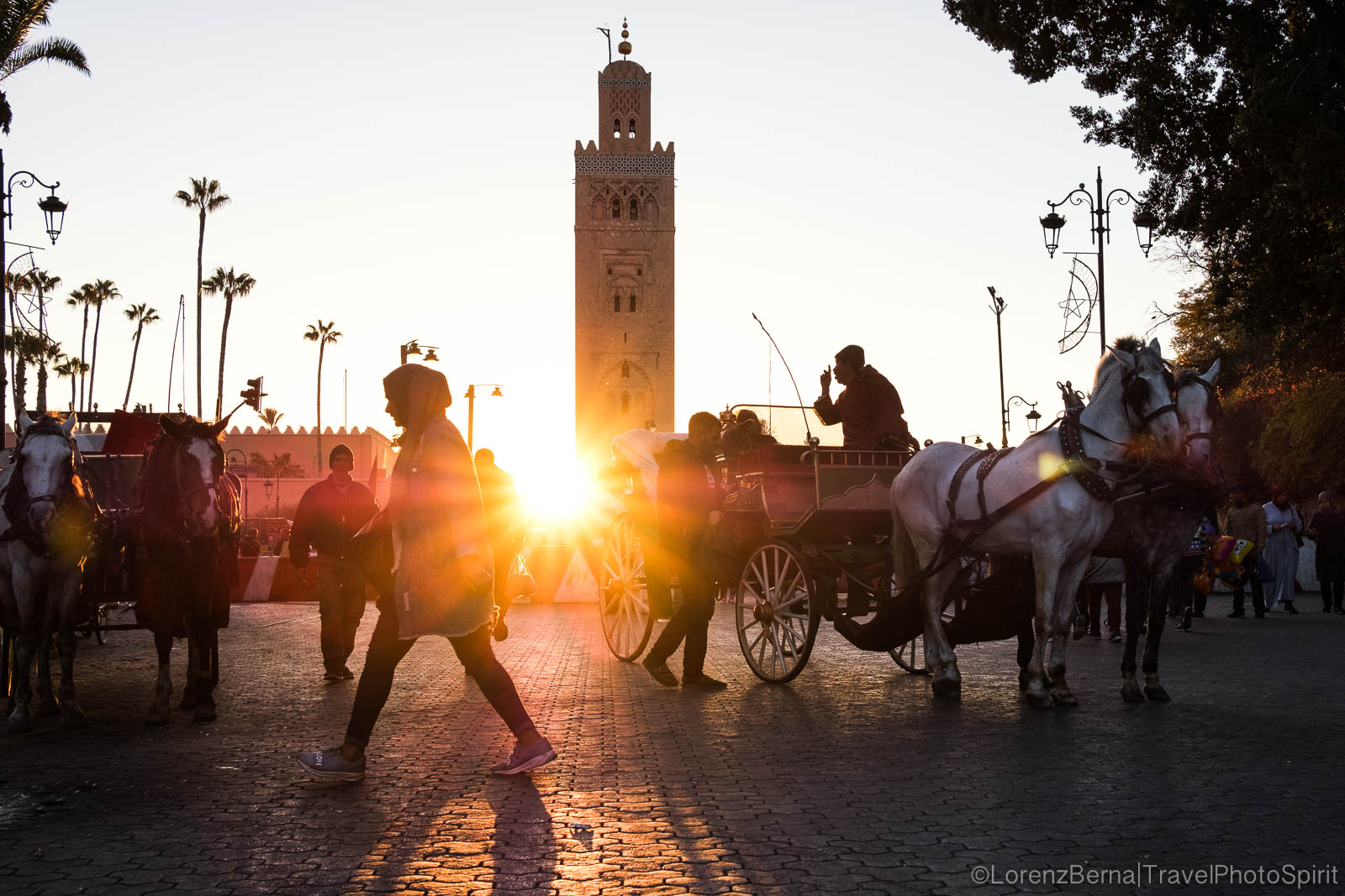 Street scene at sunset in front of the Koutoubia mosque in Marrakech