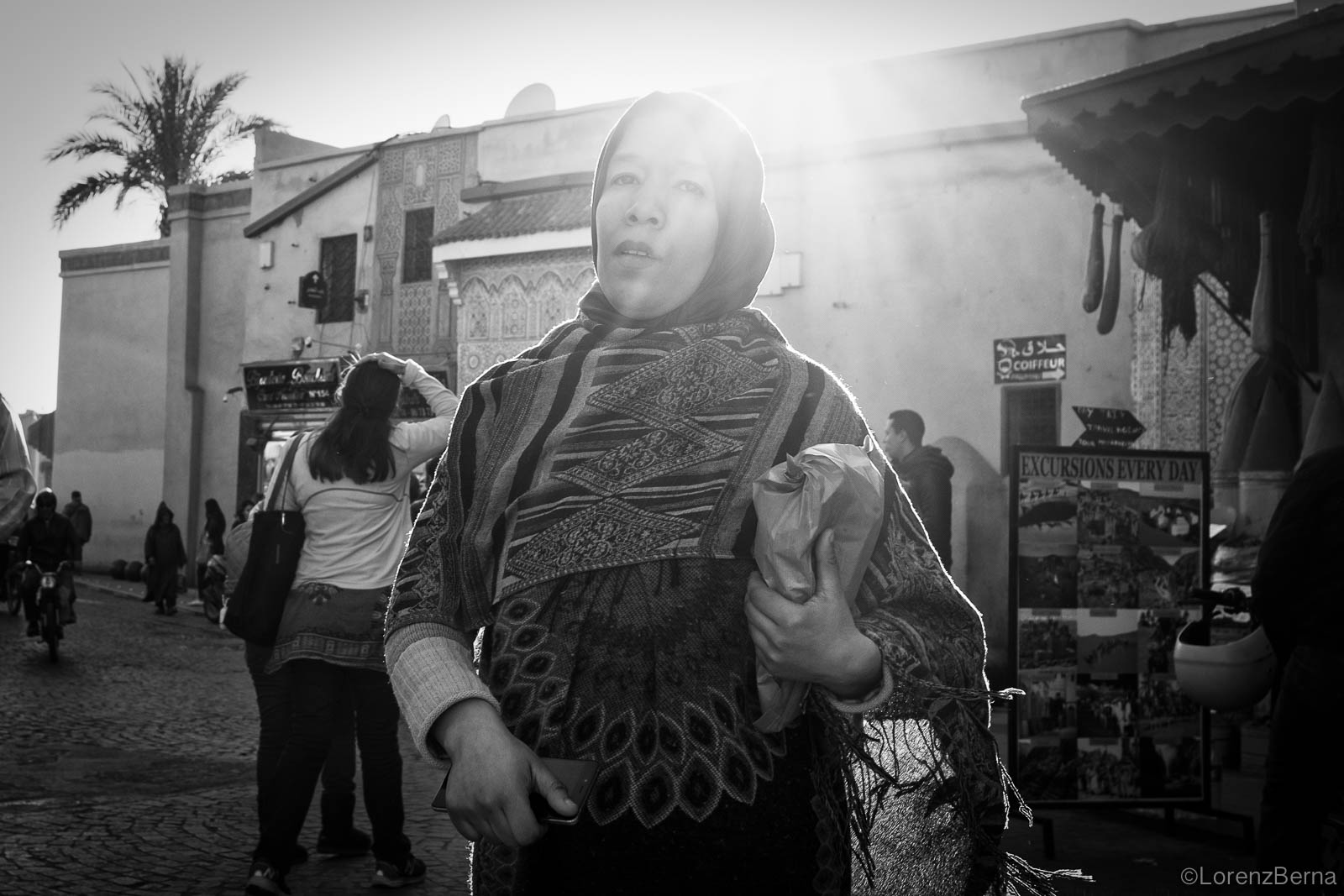 Marrakech street photography in Black and white: Moroccan woman out for shopping.
