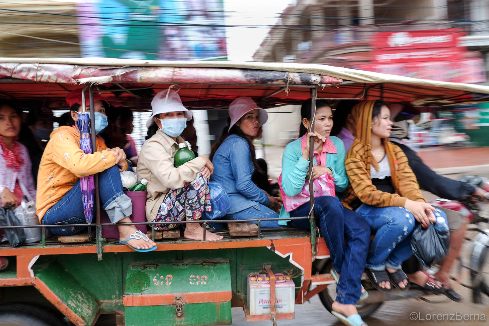 Cambodian women going to work on board of common Tuk-Tuk - Cambodia Travel Photography by Lorenz Berna